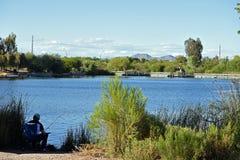 Man fishing at the main pond. Riparian Preserve Park, Gilbert, AZ, circa may 2017. Man fishing at the main pond Royalty Free Stock Images