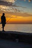 Man fishing at Malecon,  in Havana, Cuba. Royalty Free Stock Photo