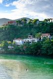 Man fishing in Marapendi Lagoon, seen from above with houses on the hill during late afternoon. Barra da Tijuca, Rio de Janeiro royalty free stock images