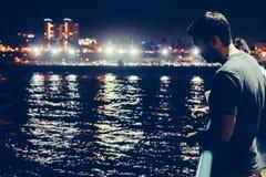 Man fishing at night