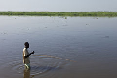 Man fishing in Nile River. BOR, SOUTH SUDAN-DECEMBER 3 2010: An unidentified man fishes in the White Nile river of South Sudan Royalty Free Stock Photos