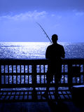 Man Fishing in Ocean Royalty Free Stock Photography