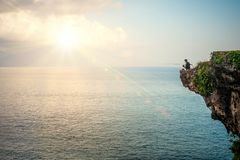 Free Man Fishing On Edge Of Cliff On The Indian Coast Royalty Free Stock Photos - 134298128