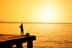 Man Fishing On The Pier Stock Photography