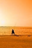 Man fishing on the pier Royalty Free Stock Image