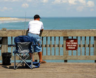 Man on fishing pier Stock Image