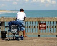 Man on fishing pier Stock Image