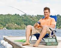 Man fishing on pier. Man fishing on a pier Stock Image