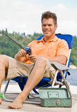 Man fishing on pier Royalty Free Stock Photos