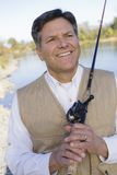 Man With Fishing Pole Royalty Free Stock Photography