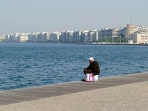 Man fishing on quayside in Thessaloniki, Greece. Patient man fishing on quayside in Thessaloniki, Greece waiting for a bite Royalty Free Stock Images