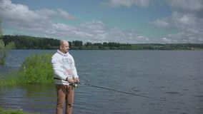 The man on fishing. Rest on the lake. stock video footage