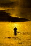 Man Fishing in River Early Morning Royalty Free Stock Images