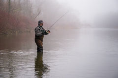 Man fishing in a river Stock Photo