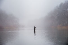 Man fishing in a river Stock Photos