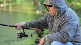 Man fishing in river stock footage