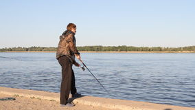 Man fishing on a river stock video