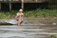 A man is fishing on a river in Vietnam Royalty Free Stock Image