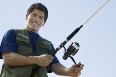 Man With Fishing Rod Stock Photo