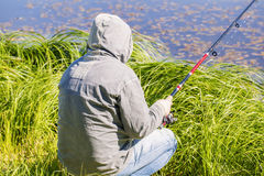 Man with fishing rod at the lake Royalty Free Stock Photos