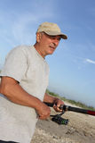 Man with fishing rod Royalty Free Stock Image