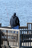 Man fishing in sea Stock Image