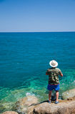 Man fishing in the sea Royalty Free Stock Images