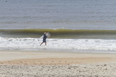 Man Fishing in the Sea With a Hand Thrown Net Stock Images