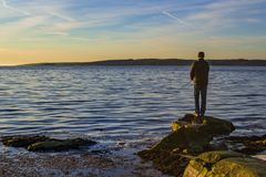 A man fishing by the sea in Sweden stock photos