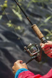 Man fishing on spinning, sunny day at the lake Stock Photos