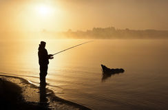 Man Fishing at Sunrise Stock Image