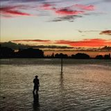 Man Fishing. With sunset Stock Images