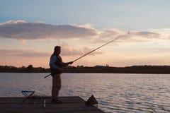 Man fishing in sunset Royalty Free Stock Photos