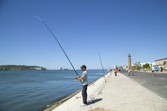 Man fishing in the Tagus river Stock Photo