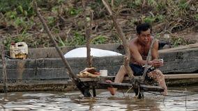 Man fishing, Tonle Sap, Cambodia Stock Photos