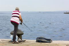 Man Fishing from Trieste`s Seafront Royalty Free Stock Photography