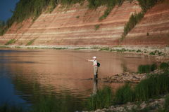 Man on a fishing trip Stock Images