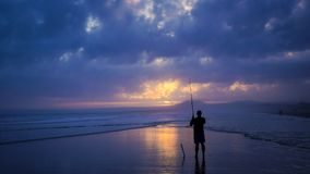 Man Fishing Under Gray Clouds in Sky Stock Image