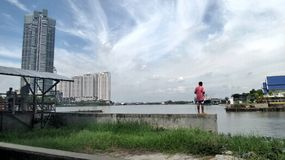 Man Fishing under white clouds  at the mouth of Chaopraya river Stock Photography