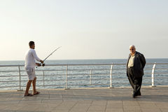 Man fishing, waterfront, Beirut. A man fishing off the waterfront in Beirut Royalty Free Stock Image