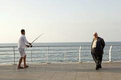Man fishing, waterfront, Beirut Royalty Free Stock Image