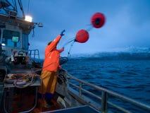 Man on fishingboat Stock Image