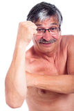 Man fist gesturing. Naked middle aged man gesturing with fist, isolated on white background Stock Image