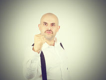 Man fist raised menacing threat. emotions and people concept. Isolated Stock Photos