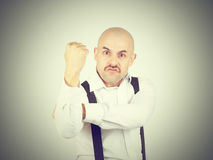 Man fist raised menacing threat. emotions and people concept Stock Photos