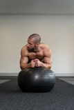 Man On Fitness Ball Exercising Abs Stock Image