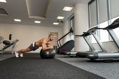Man On Fitness Ball Exercising Abs Stock Photography