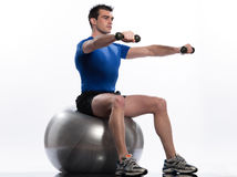 Man fitness ball Workout Posture weigth training. One caucasian man exercising workout weigth training sitting on fitness swiss ball full length isolated on Stock Images