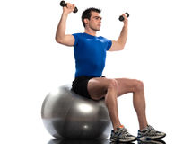 Man fitness ball Workout Posture weigth training. One caucasian man exercising workout weigth training sitting on fitness swiss ball full length isolated on Royalty Free Stock Photography