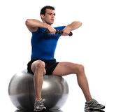 Man fitness ball Workout Posture weigth training. One caucasian man exercising workout weigth training sitting on fitness swiss ball full length isolated on Stock Photos